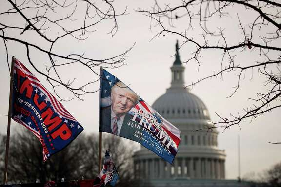 With the U.S. Capitol in the background, 'Trump' flags fly on top of a merchandise stand on North Capitol Street, Jan. 19, 2017 in Washington.  Trump will be inaugurated as the 45th U.S. President on Friday. (Photo by Drew Angerer/Getty Images)