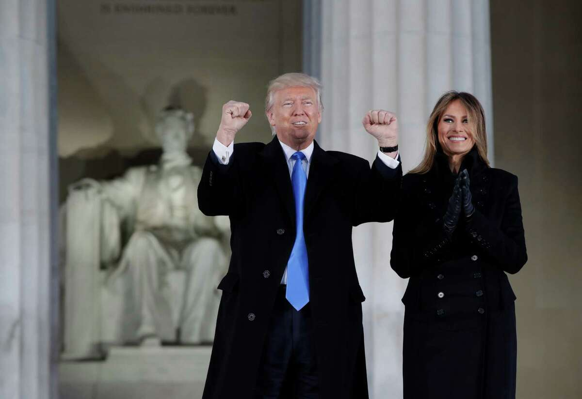 """President-elect Donald Trump and his wife Melania Trump arrive at a pre-Inaugural """"Make America Great Again! Welcome Celebration"""" at the Lincoln Memorial in Washington, Thursday, Jan. 19, 2017. (AP Photo/Evan Vucci)"""