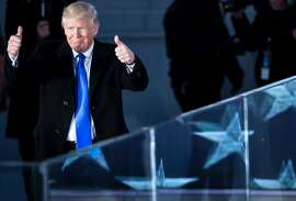 US President-elect Donald Trump gestures during a welcome celebration at the Lincoln Memorial in Washington, DC, on January 19, 2017. / AFP PHOTO / Brendan SmialowskiBRENDAN SMIALOWSKI/AFP/Getty Images