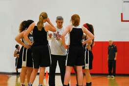 Tomball Rosehill Christian Girls Basketball head coach Steve Krantz coaches up the Lady Eagles at practice Wednesday. Krantz's team has faced some challenges, notably fielding only six players for most of their games, but have performed admirably, winning their first two district contests and 17 overall.