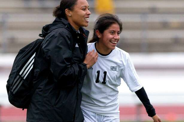 Conroe's Marcela Ramirez (11) celebrates with head coach Kesha Cauley after scoring both goals in the team's 2-1 win over Alief Hastings during a match in the Spring ISD girls soccer tournament at Leonard George Stadium Thursday, Jan. 19, 2017, in Spring.