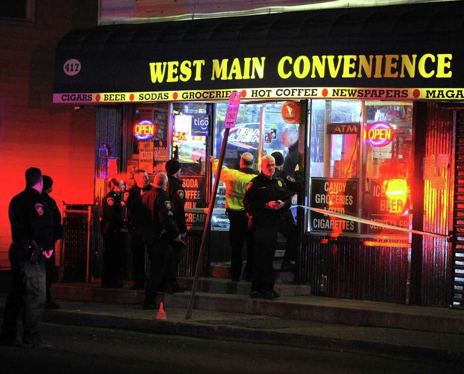 Stamford police investigate the scene of a shooting inside West Main Convenience on West Main Street in Stamford on Jan. 19, 2017. One victim was reported to have been shot in the head as police canvass the West side neighborhood for witnesses. Photo: Matthew Brown / Hearst Connecticut Media / Stamford Advocate