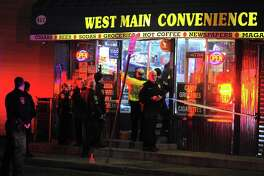 Stamford police investigate the scene of a shooting inside West Main Convenience on West Main Street in Stamford on Jan. 19, 2017. One victim was reported to have been shot in the head as police canvass the West side neighborhood for witnesses.