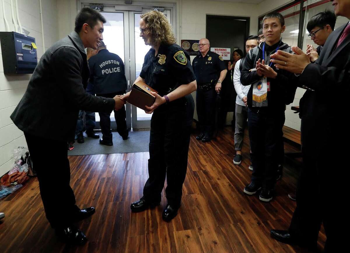 Yao-Han Wu, division leader of Taiwan's Central Police University, thanks Capt. Lori Bender as she leads a tour for the approximately two dozen special police cadets.