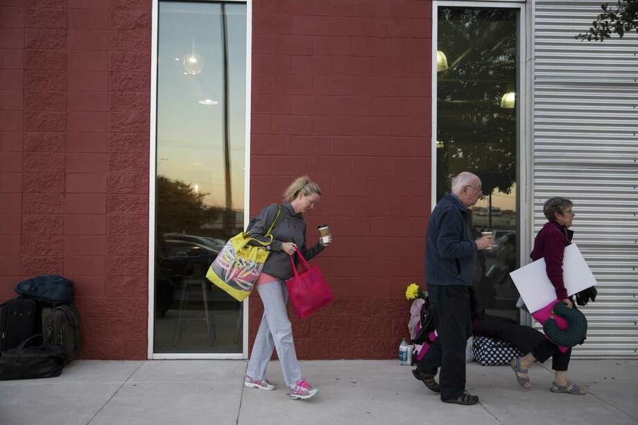 Victoria Rogers, left, of Corpus Christi, Carol Ward, and her husband Bill Ward walk towards the buses before the women departed for the Women's March on Washington outside the TriPointe YMCA in San Antonio, Texas on January 19, 2017. Photo: Carolyn Van Houten, Staff / San Antonio Express-News / 2017 San Antonio Express-News