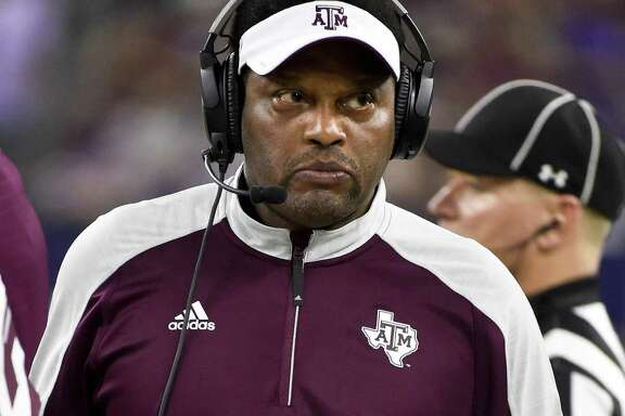 Texas A&M coach Kevin Sumlin walks the sideline during the second half of the Texas Bowl against Kansas State on Dec. 28, 2016, in Houston. Kansas State won 33-28.