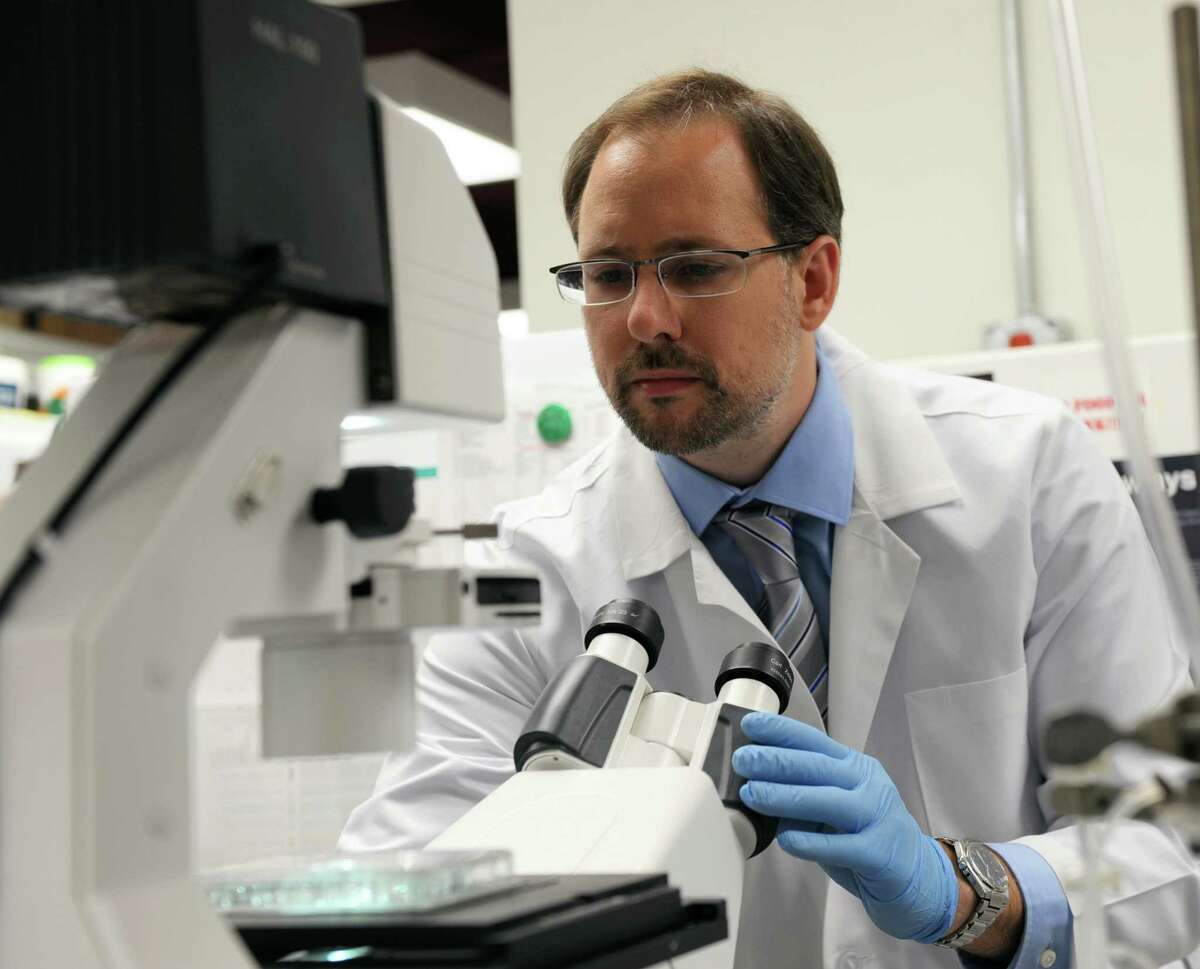 Alejandro Adam, assistant professor at Albany Medical College, works in his lab January 19, 2017 in Albany N.Y. Adam was one of five Capital Region researchers awarded for their work by the BACC Academy, a partnership between Albany Medical College and Siena College that helps reseachers and students navigate the biomedical business world. (Robert Downen/Times Union)