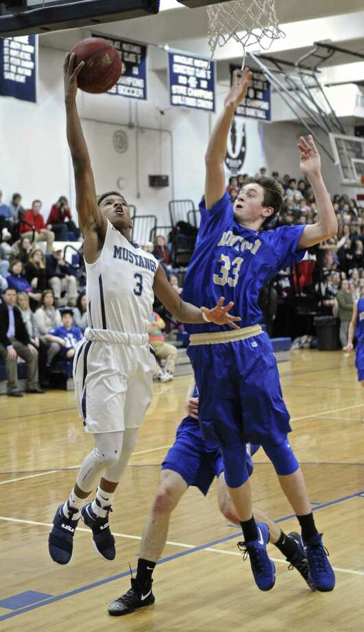 Immaculate's Donte Williams (3) drives to the basket past Newtown's Robert Disibio (33) in the boys high school basketball game between Newtown and Immaculate high schools, on Thursday night, January 19, 2017, at Immaculate High School, in Danbury, Conn. Photo: H John Voorhees III / Hearst Connecticut Media / The News-Times
