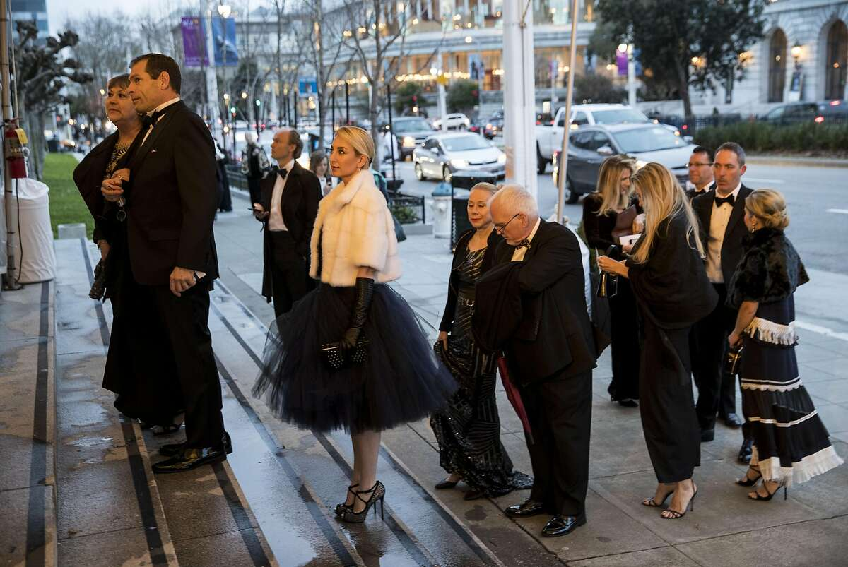 Guests of the San Francisco Ballet 2017 Opening Night Gala line up along Van Ness Avenue to enter City Hall for the event in San Francisco, Calif., on Thursday, January 19, 2017. The theme of the evening was Ever Magical.