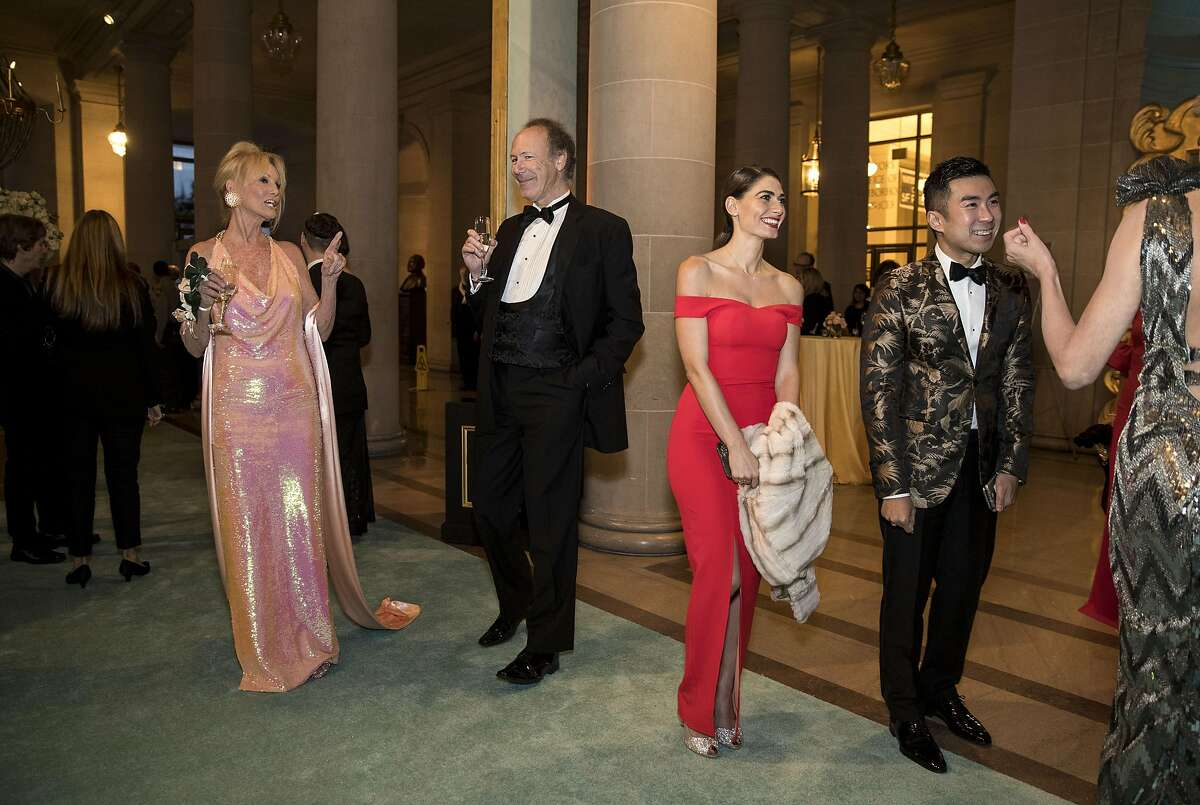 Belinda Berry, Tom Barrett, Ellian Rafful and Kai Tan (left to right) enjoy the cocktail hour while attending the San Francisco Ballet 2017 Opening Night Gala at City Hall in San Francisco, Calif., on Thursday, January 19, 2017. The theme of the evening was Ever Magical.
