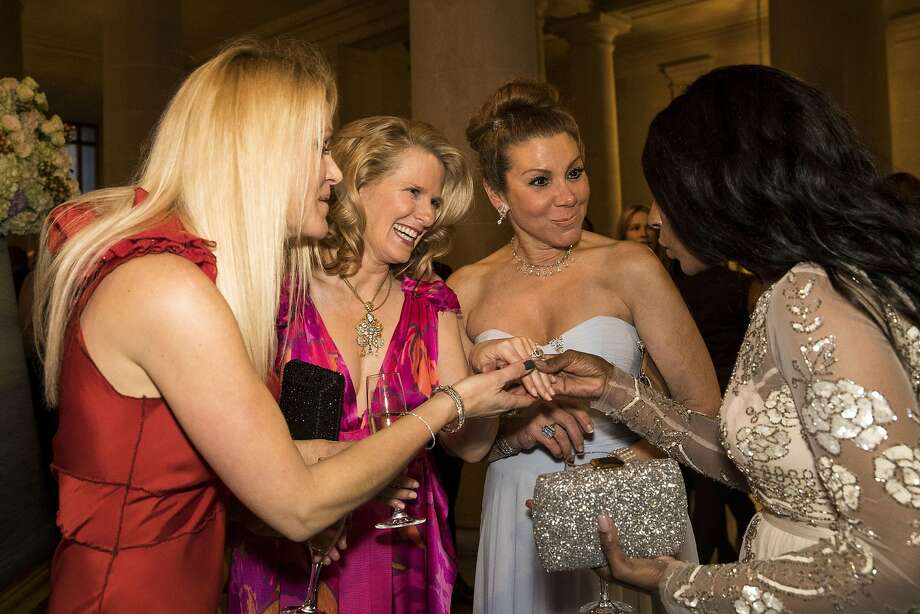Maria Ralph, Marie Hurabiell, Debra Leylegian and Pernella Sommerville (left to right) discuss Hurabiell's engagement ring while attending the cocktail hour of the San Francisco Ballet 2017 Opening Night Gala at City Hall in San Francisco, Calif., on Thursday, January 19, 2017. The theme of the evening was Ever Magical. Photo: Laura Morton, Special To The Chronicle