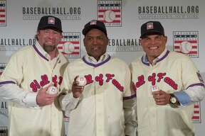 Newly elected baseball Hall of Fame inductees Jeff Bagwell, left, Tim Raines, center, and Ivan Rodriguez, poses for a photo during a news conference, Thursday, Jan. 19, 2017, in New York. (AP Photo/Mary Altaffer) ORG XMIT: NYMA108