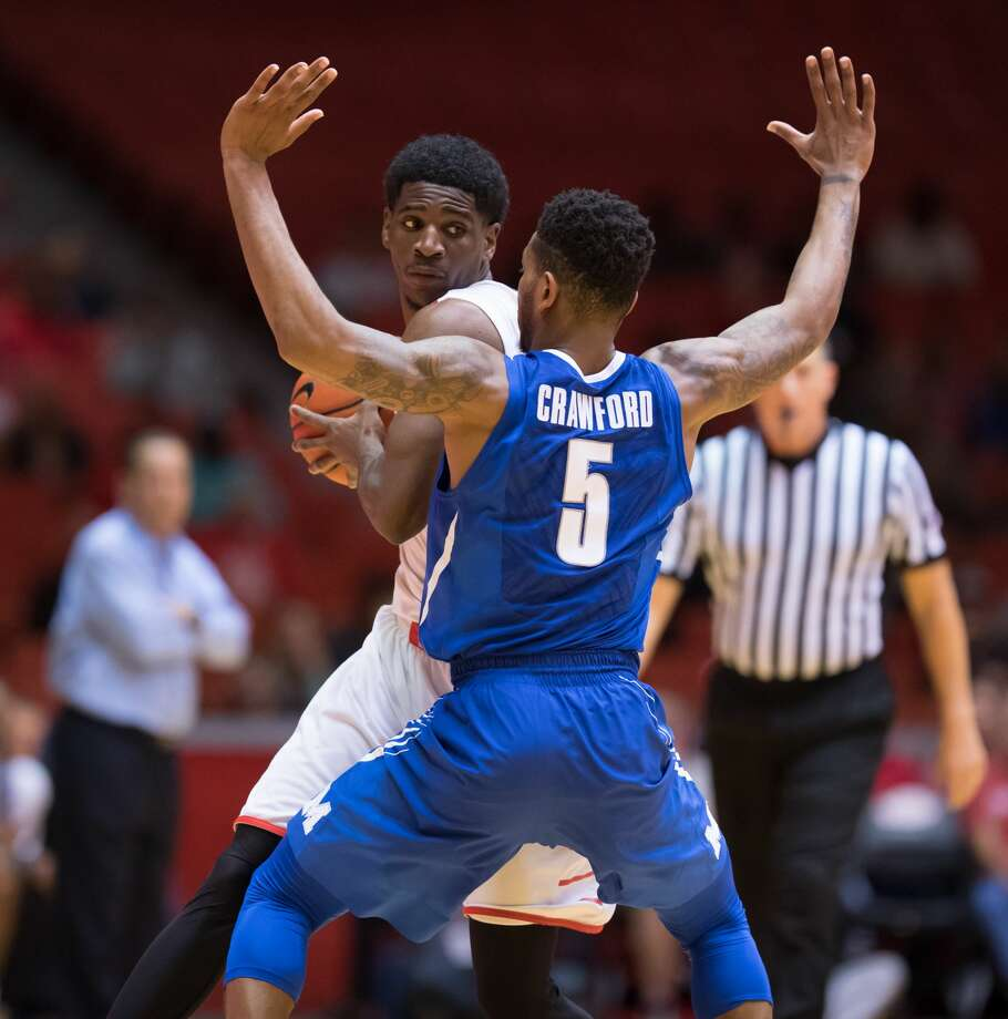 Damyean Dotson (21) of the Houston Cougars attempts to dribble the around Markel Crawford (5) of the Memphis Tigers in the first half of a college basketball game on Thursday, January 19, 2017 at Hofheinz Pavilion. Photo: Wilf Thorne/For The Chronicle