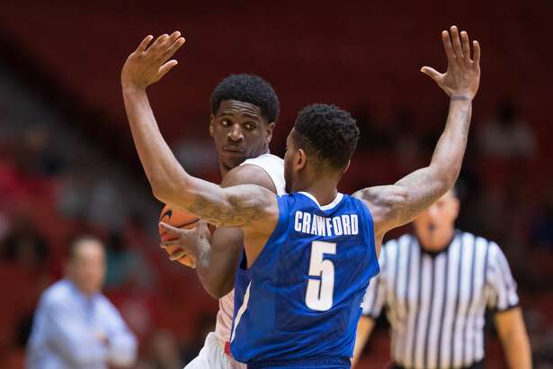Damyean Dotson (21) of the Houston Cougars attempts to dribble the around Markel Crawford (5) of the Memphis Tigers in the first half of a college basketball game on Thursday, January 19, 2017 at Hofheinz Pavilion.