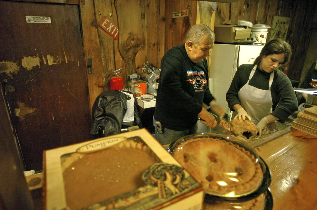 Don Birch, owner of The Saw Mill Tavern, and Danielle Zoerner, a cook at the tavern, work on removing turkey off the bone to serve patrons at The Saw Mill Tavern in Schenectady, N.Y. on Nov. 23, 2006. (Times Union staff photo by Paul Buckowski)