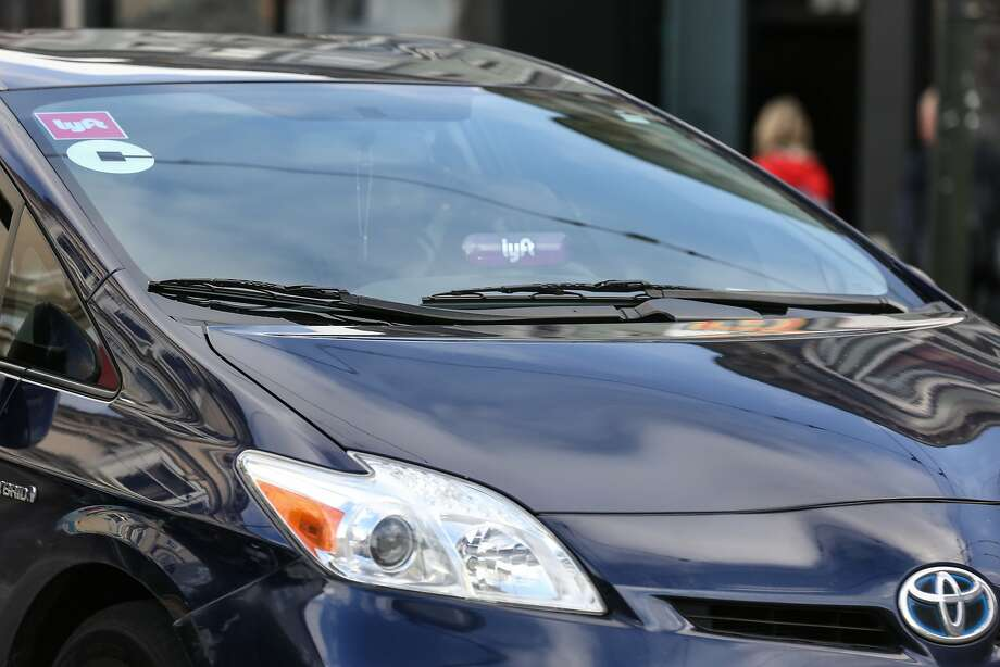 Many drivers work for both Uber and Lyft. Consumers, too, are discovering they have a choice. Photo: Amy Osborne, Special To The Chronicle