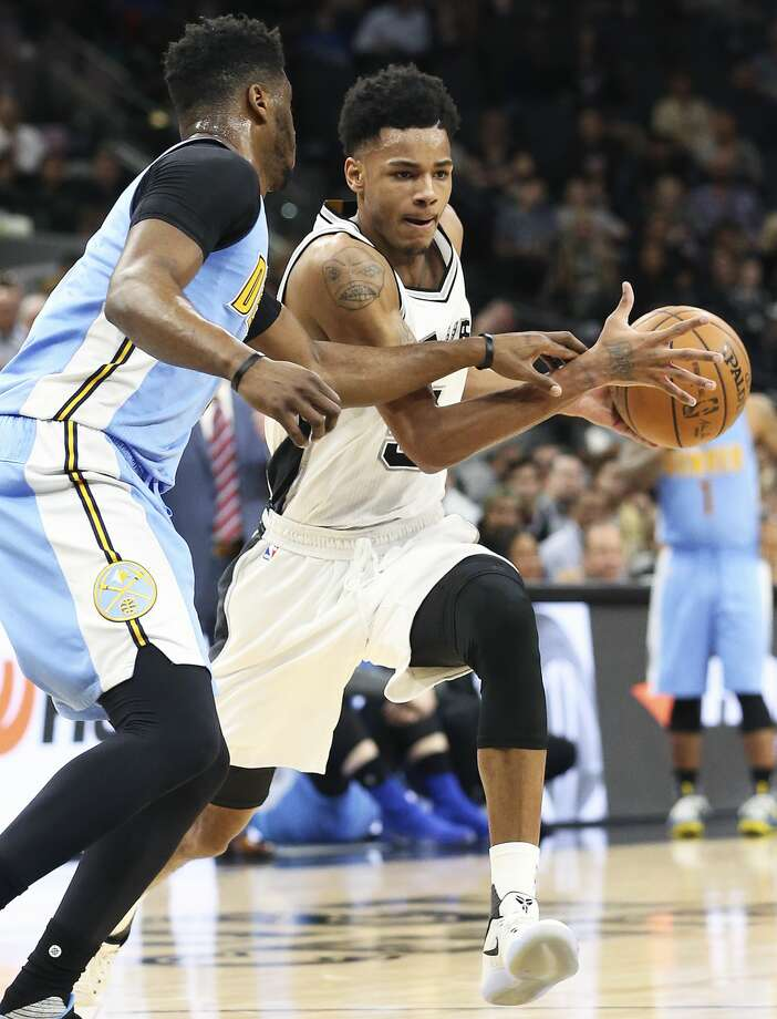 Dejounte Murray moves into the paint on a play in the first half as the Spurs host Denver at the AT&T Center on January, 19, 2017. Photo: Tom Reel/San Antonio Express-News