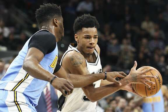 Dejounte Murray moves into the paint on a play in the first half as the Spurs host Denver at the AT&T Center on January, 19, 2017.