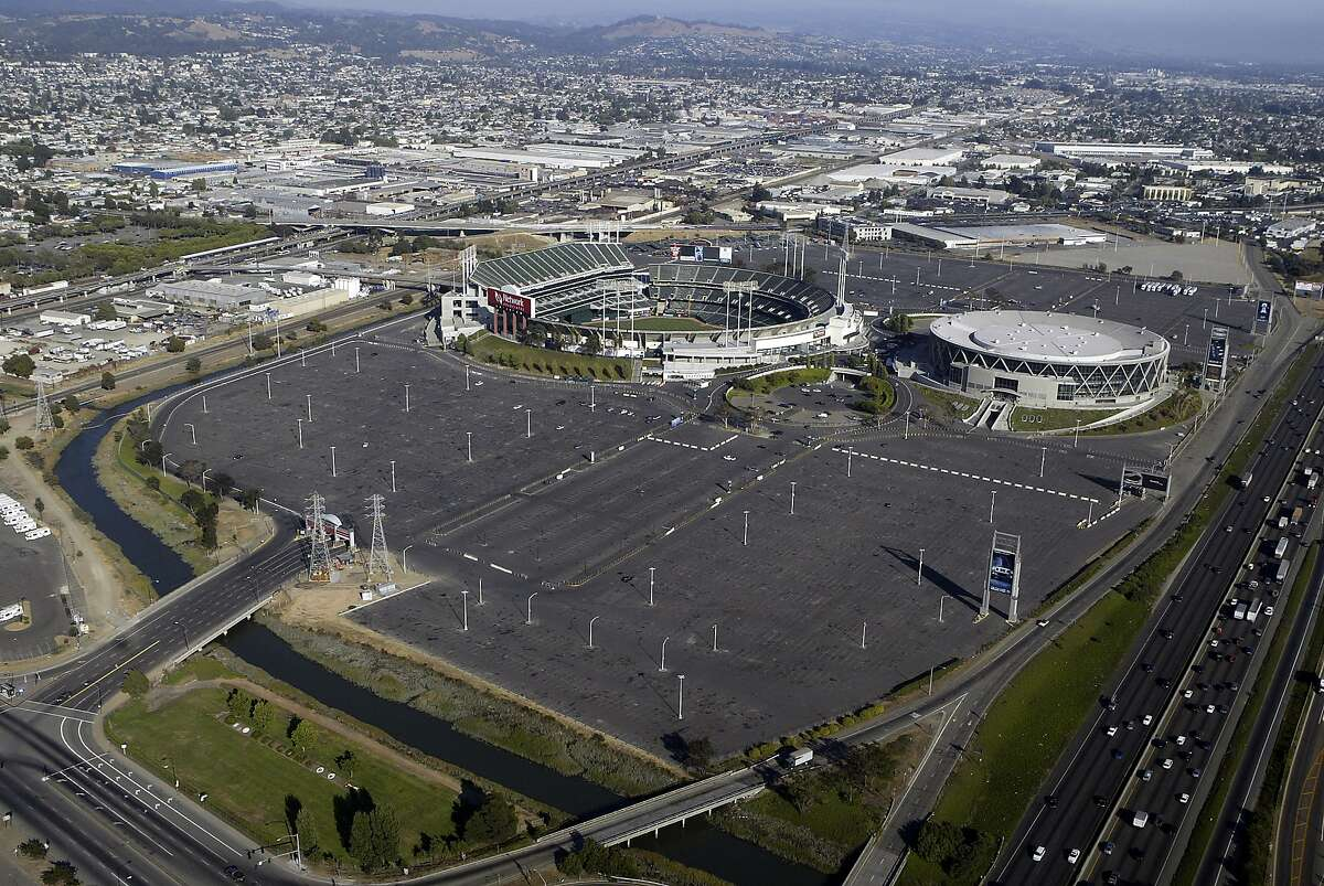 Oakland Coliseum and Oracle Arena with parking lots.