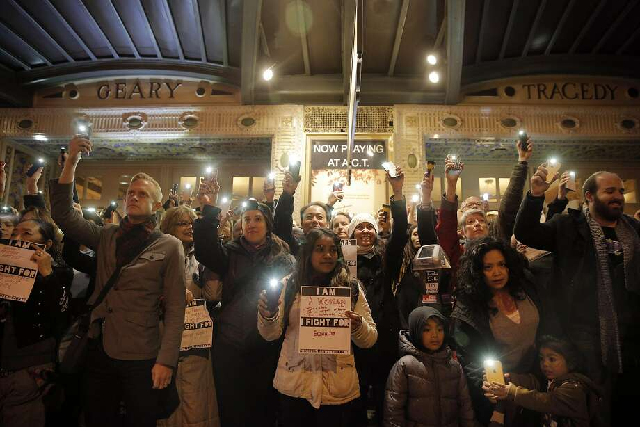 Theater artists and their families and supporters stand with lights outside the Geary Theater in San Francisco. Photo: Carlos Avila Gonzalez, The Chronicle