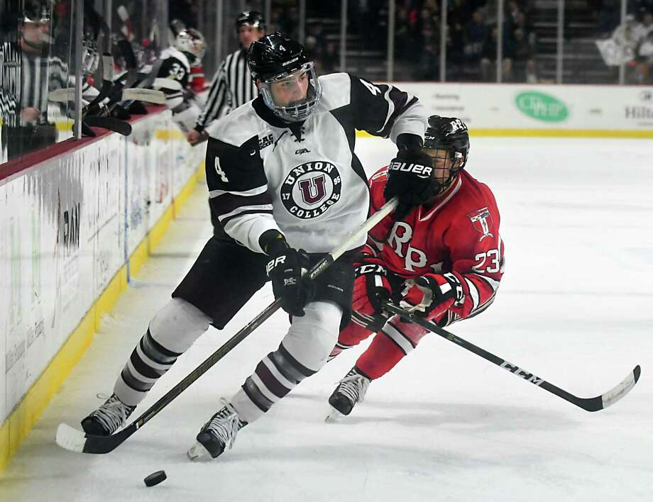 Union's Nick DeSimone is defended by RPI's Lou Nanne during the Mayor's cup hockey game at the Times Union Center on Thursday, Jan. 19, 2017 in Albany, N.Y. (Lori Van Buren / Times Union) Photo: Lori Van Buren / 20039466A