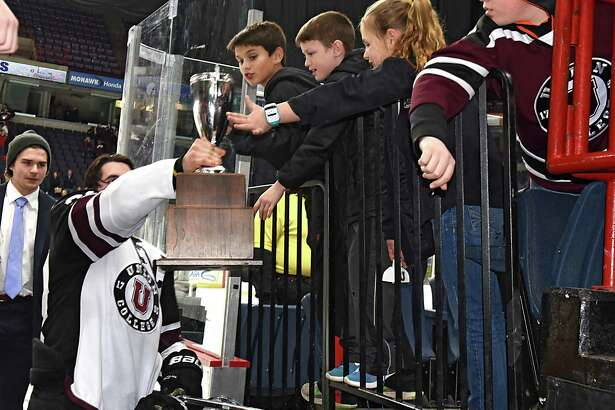 Kids are happy to touch the trophy after Union defeated RPI in the Mayor's cup game at the Times Union Center on Thursday, Jan. 19, 2017 in Albany, N.Y. (Lori Van Buren / Times Union)