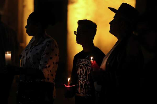 People attend a candle light vigil, in Main Plaza Thursday Jan. 19, 2017, in support of refugees, immigrants, and others who feel threatened by the incoming Donald Trump administration. About 50 people attended the vigil led by RAICES.