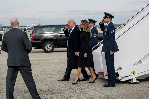 President-elect Donald Trump and his wife, Melania, walk off a military airplane as they arrive the day before his inauguration at Joint Base Andrews in Maryland, Jan. 19, 2017. (Doug Mills/The New York Times) ORG XMIT: XNYT42