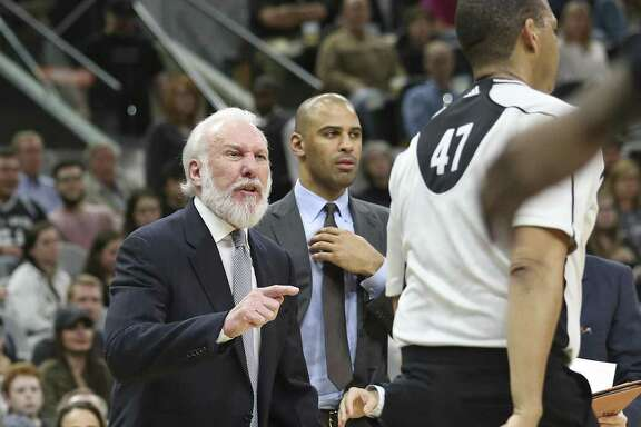 Gregg Popovich goes after referee Bennie Adams and gets ejected from the game as the Spurs host Denver at the AT&T Center on January, 19, 2017.