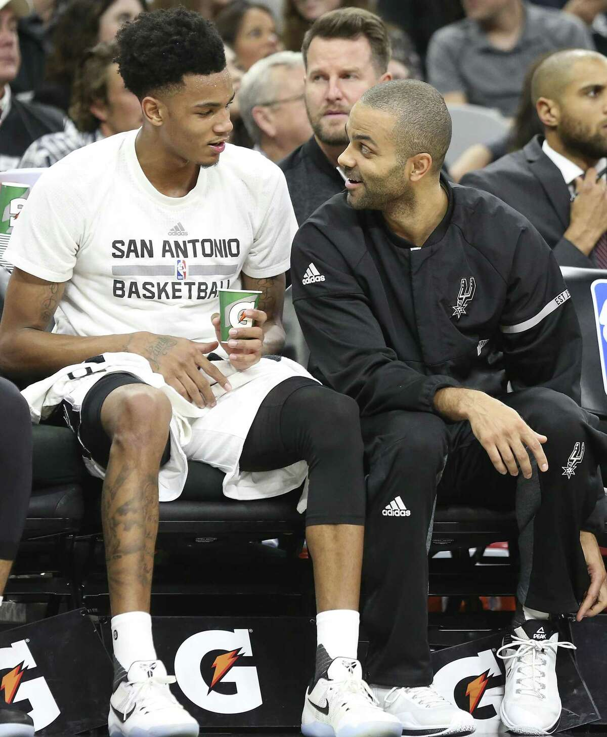 Tony Parker chats with Dejounte Murray on the bench as the Spurs host Denver at the AT&T Center. Murray was given the starting point guard spot over Parker in January 2018.