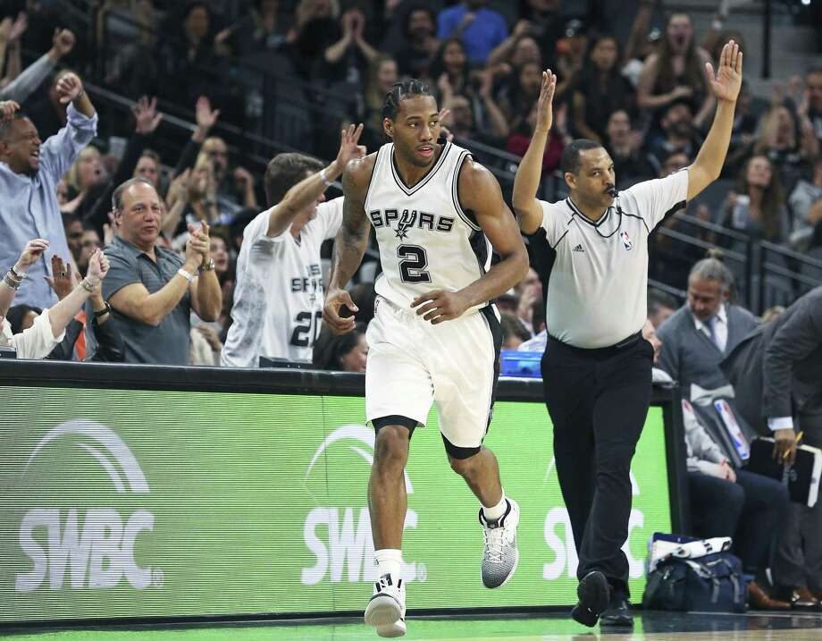 Kawhi Leonard heads up court after hitting a 3-point shot against Denver on Jan. 19. Photo: Tom Reel /San Antonio Express-News / 2017 SAN ANTONIO EXPRESS-NEWS