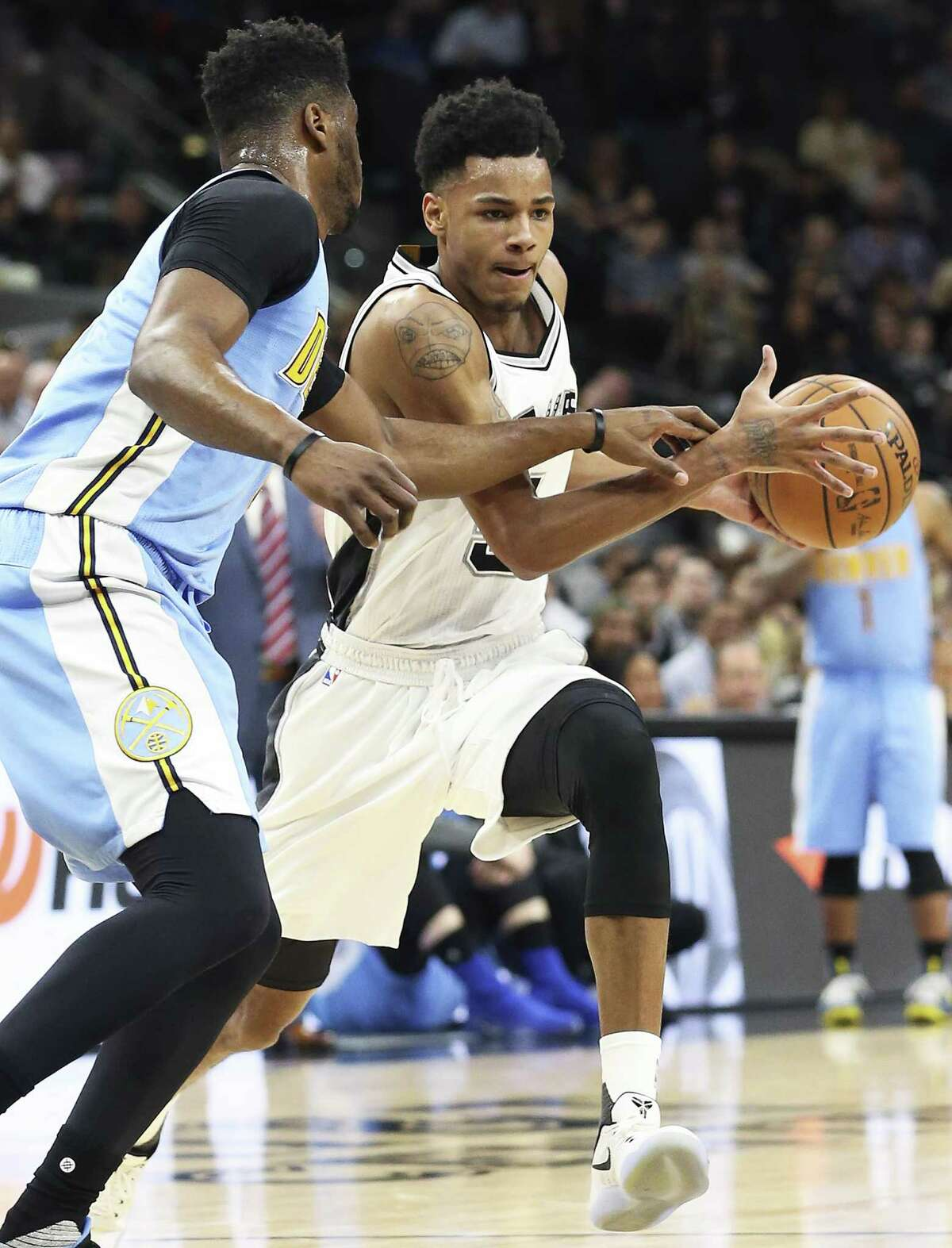 Dejounte Murray moves into the paint in the first half as the Spurs host Denver at the AT&T Center on Jan. 19, 2017.