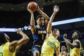 Oregon guard Payton Pritchard (3), defends California forward Ivan Rabb (1) in an NCAA college basketball game Thursday, Jan. 19, 2017, in Eugene, Ore. Oregon beat California 86-63. (AP Photo/Thomas Boyd)