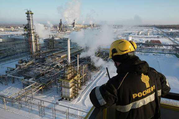 A worker overlooks a unit of Russia's Novokuibyshevsk oil refinery. Russia was among the nations that agreed to trim their oil production.