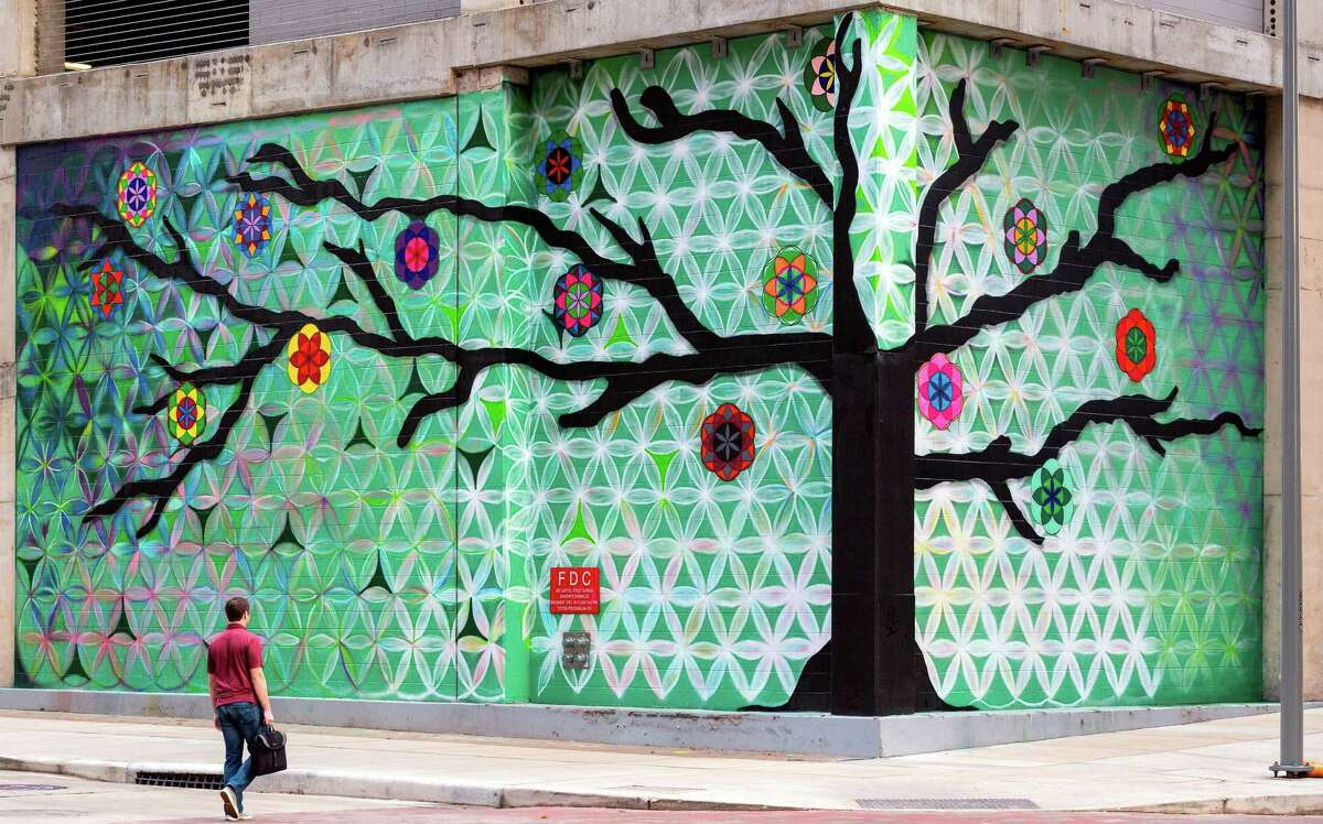 """Skanska has unveiled the """"Tree of Life"""" mural wrapping around its Capitol Tower development at Rusk and Travis in downtown Houston. The project is one of four public art murals initiated by Houston City Council Member Amanda Edwards in cooperation with the Houston Super Bowl Host Committee.The five-story structure at Capitol Tower site currently serves as a contract parking garage. Skanska will move forward on building the 750,000-square-foot office tower after securing tenants."""
