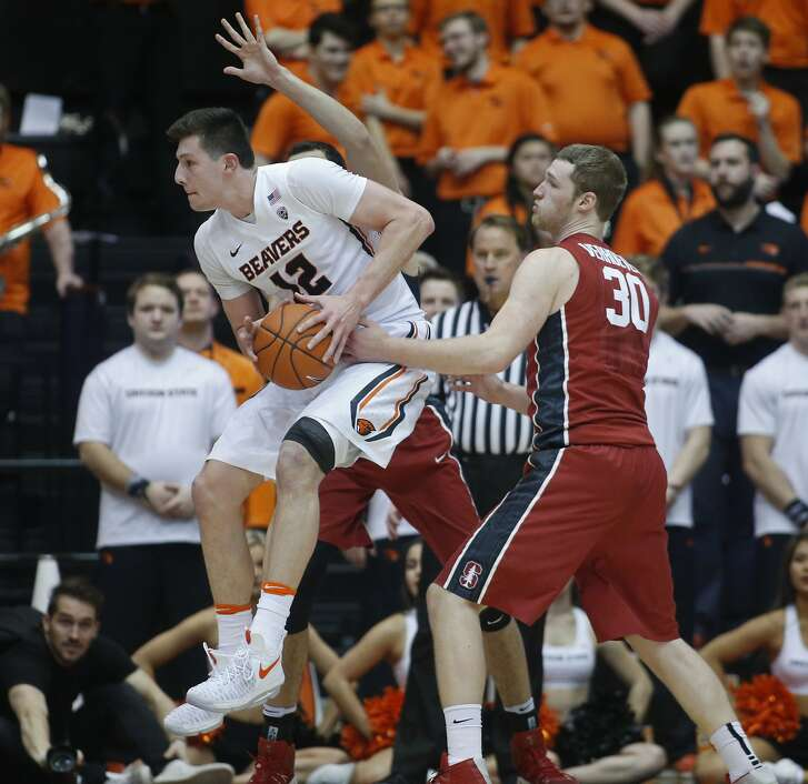 Oregon State's Drew Eubanks (12) jumps past Stanford's Grant Verhoeven (30) during first half of an NCAA college basketball game in Corvallis, Ore., Thursday, Jan. 19, 2017. (AP Photo/Timothy J. Gonzalez)