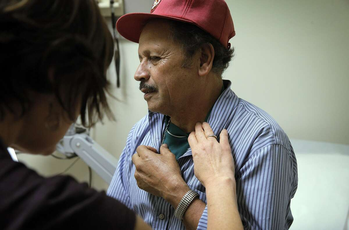 Nurse Practitioner Jennifer Huggans-Zapeta, gives patient Antonio Avila a quick check up during a visit at La Clinica de La Raza in Oakland, Calif., on Thursday, January 19, 2017. Bay Area clinics like Clinica de la Raza had been staffing up for years in order to treat the flood of low-income patients who became eligible for Medi-Cal under the Affordable Care Act's Medicaid expansion. Now, as Republicans in Congress take steps to repeal the health law, the clinics are grappling with what staffing and budget changes they should make to continue serving a vulnerable population.
