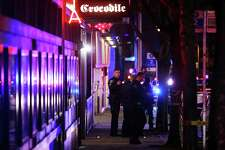 Seattle Police investigate outside The Crocodile Cafe, where three people were shot just before 11 p.m., Thursday night. Two people were shot inside the club and one outside. Hundreds of teens who were there to see the rapper A Boogie ran outside onto 2nd Street.
