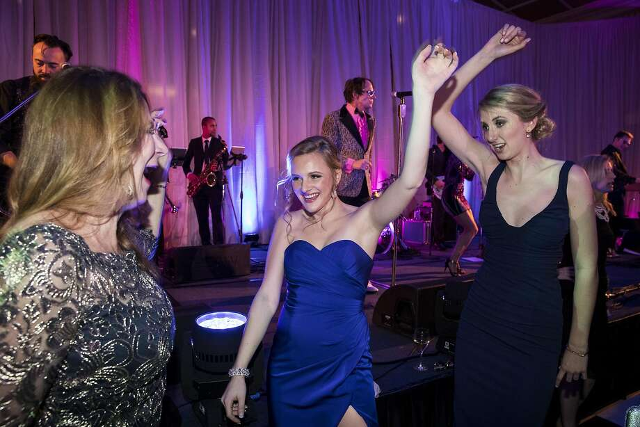 Patricia Ferrin, Sarah Seltsam and Audrey Riedel (left to right) dance to the 80s cover band Pop Rocks during the after party for the San Francisco Ballet 2017 Opening Night Gala at City Hall in San Francisco, Calif., on Thursday, January 19, 2017. The theme of the evening was Ever Magical. Photo: Laura Morton, Special To The Chronicle