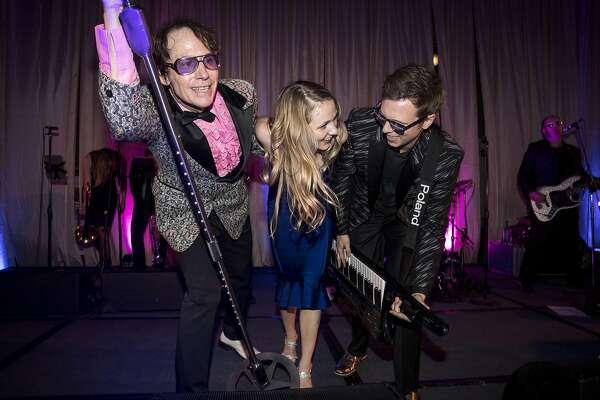 Lauren Wilmot (center) joins the 80s cover band Pop Rocks on the stage during the after party for the San Francisco Ballet 2017 Opening Night Gala at City Hall in San Francisco, Calif., on Thursday, January 19, 2017. The theme of the evening was Ever Magical.