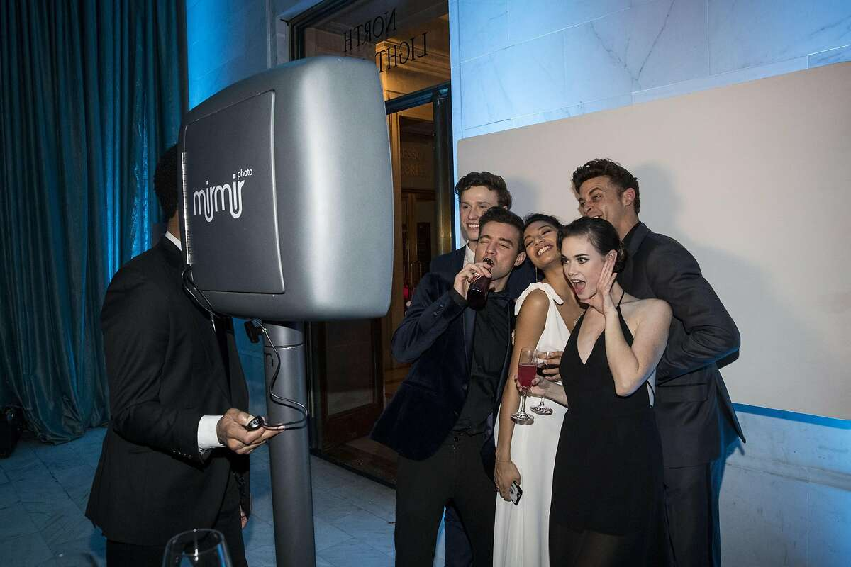 San Francisco Ballet company members Ben Freemantle, Diego Cruz, Isabella Devivo, Elizabeth Powell and Taras Domitro (left to right) pose together at the photo booth during the after party for the San Francisco Ballet 2017 Opening Night Gala at City Hall in San Francisco, Calif., on Thursday, January 19, 2017. The theme of the evening was Ever Magical.