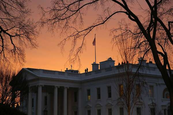 The early morning sun begins to rise behind the White House, on January 20, 2017 in Washington, DC. At 12 noon today President-elect Trump will be sworn in as the nation's 45th president during an inaugural ceremony at the U.S. Capitol. (Photo by Mark Wilson/Getty Images)