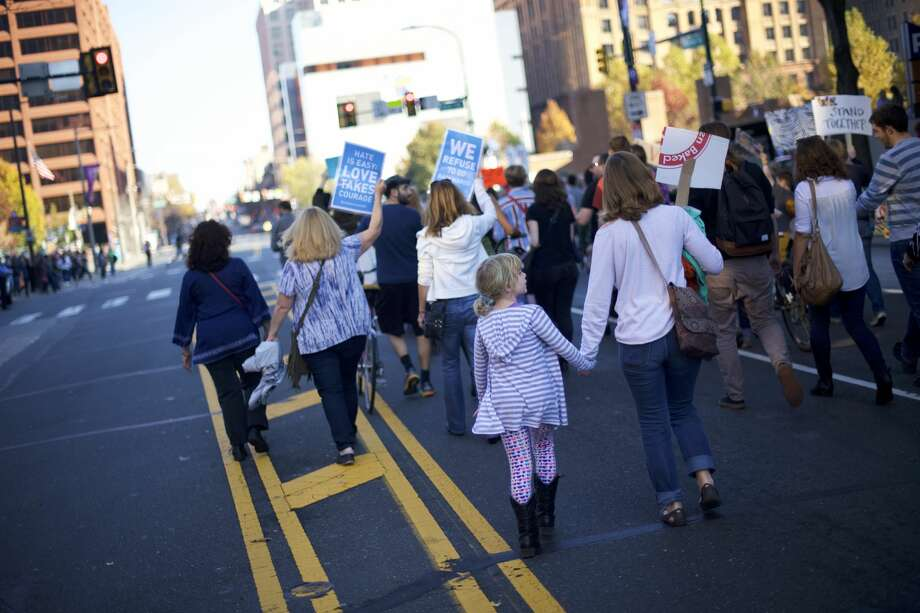 PHILADELPHIA, PA - NOVEMBER 19:  A mother and daughter joined more than a thousand protestors in a march to Independence Hall against President-elect Donald Trump November 19, 2016 in Philadelphia, Pennsylvania.  Today marks the 11th consecutive day of anti-Trump protests in Philadelphia, with plans to demonstrate everyday through inauguration day, January 20, 2017.  (Photo by Mark Makela/Getty Images) Photo: Mark Makela/Getty Images