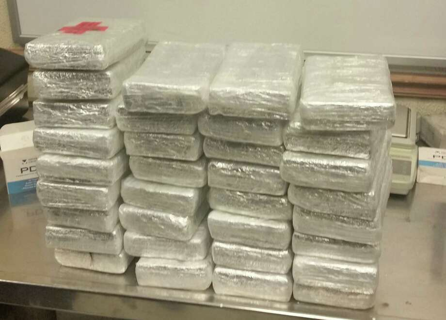 CBP officers discovered 33 packages hidden in a vehicle containing 76 pounds of cocaine on Saturday. Photo: Courtesy Photo