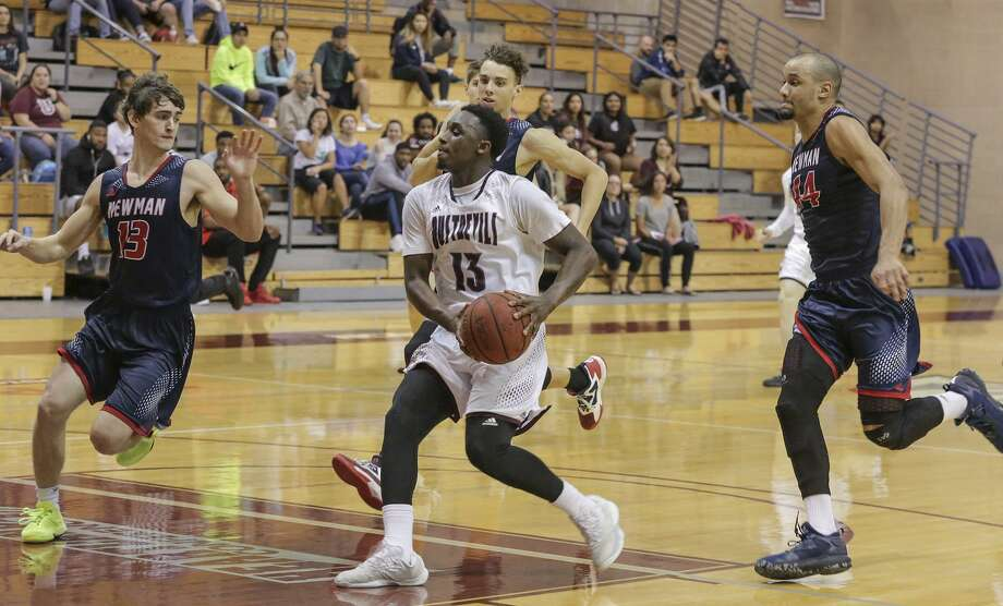 Ahead by 14 points with 3:30 left, TAMIU found itself in overtime at Newman Saturday. But with the help of Denzel Bellot's season-high 28 points, the Dustdevils won 100-95 to clinch a share of the school's fifth Heartland Conference title since 2011. Photo: Victor Strife /Laredo Morning Times File