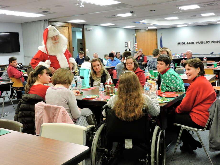 Santa visits with AKtion Club members and guests at the Holiday Party.