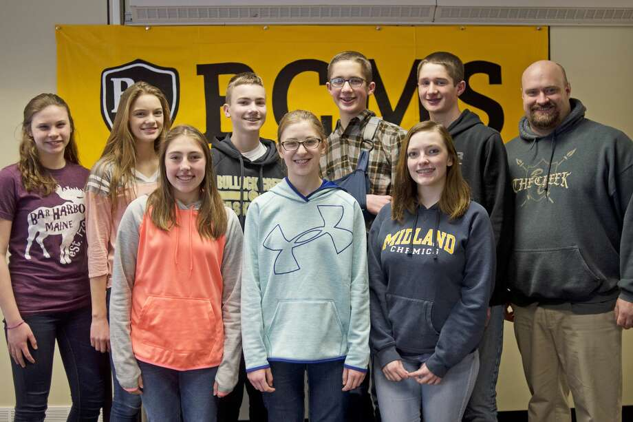 ERIN KIRKLAND | ekirkland@mdn.net Back row from left: Bullock Creek 8th graders Ella Moses, 13, Anna Marie DeBolt, 14, Seth Bradford, 14, Austin West, 13, Zachary West, 13, 8th grade history teacher George Whittington, (front row from left) Kaylee Monville, 13, Karlee Szafranski, 13, Kayla Giardina, 14, pose for a photo on Wednesday at Bullock Creek Middle School. George Whittington's class won the 2016 Electoral College Prediction Contest, sponsored by the Michigan Council for History Education, which allowed them to view the electoral process in Lansing. Photo: Erin Kirkland/Midland Daily News/Erin Kirkland