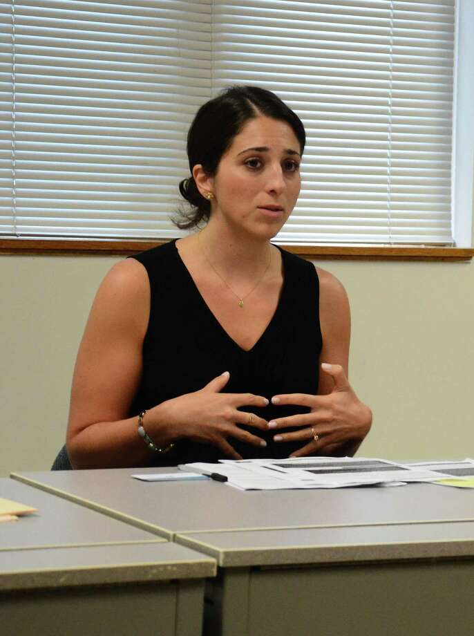 Setta Mushegian, of the Stamford-based Center for Sexual Assault Crisis Counseling and Education, talks about ways college students should arm themselves against sexual violence on campus. Mushegian and other local sexual assault and domestic violence experts met to discuss such topics with town leaders Monday, July 21, 2014, at the New Canaan Police Department, in New Canaan, Conn. Photo: Nelson Oliveira / Hearst Connecticut Media / New Canaan News