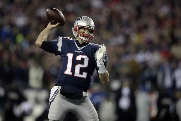 New England Patriots quarterback Tom Brady passes against the Baltimore Ravens during the first half in Foxborough, Mass., on Dec. 12, 2016.