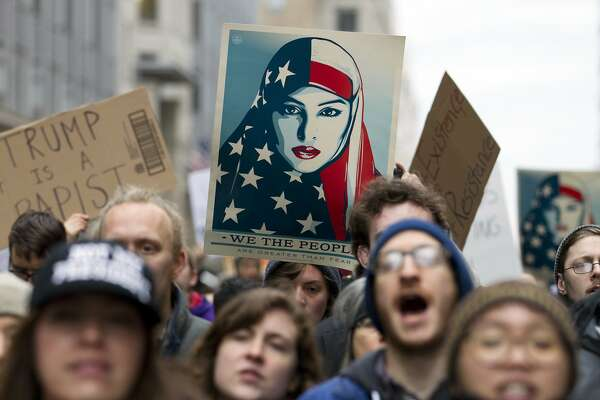 Demonstrators march on the street near a security checkpoint inaugural entrance, Friday, Jan. 20, 2017 in Washington, ahead of President-elect Donald Trump's inauguration. Protesters pitching diverse causes but united against the incoming president are making their mark on Inauguration Day.  ( AP Photo/Jose Luis Magana)
